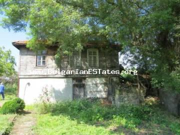 Buy a house in Bulgaria near the sea . For sale is Old Bulgarian house with large garden in the village of  Velika 3km from  Lozenets and the sea.