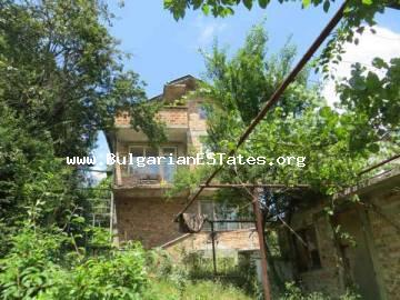 For sale is massive two-storey house for sale in the village of Vurshilo, 35 km from the sea and the city of Bourgas, Bulgaria.