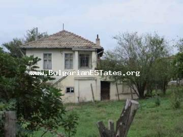 Massive two-storey house is for sale in the village of Veselie, 14 km from the seaside town of Sozopol and 25 km from the city of Bourgas, Bulgaria.