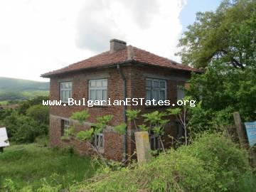 A large solid house with an incredible view is offered for sale in the village of Izgrev only 3 km from the sea and the town of Tsarevo.