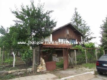 The two-storey house is offered for sale in the village of Chernozem, located in the centre of the village.