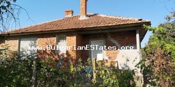 One-storey house is for sale affordably with a large yard in Svetlina village, 35 km from the sea and the city of Burgas.
