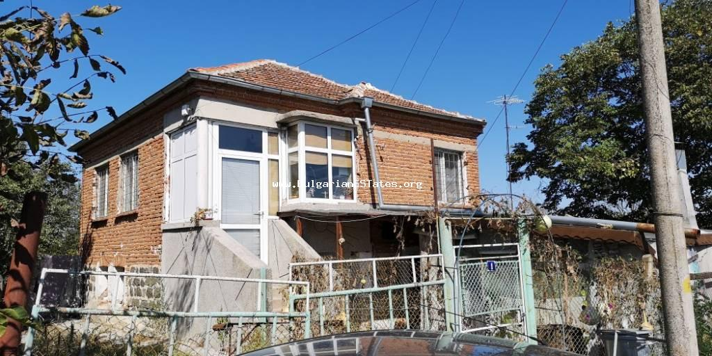 A two-storey house is offered for sale in the village of Dyulevo, 25 km from the city of Burgas and the sea.