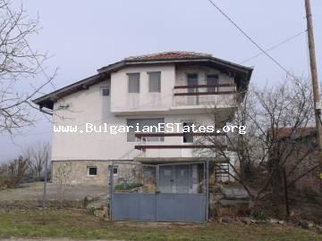 "A three-storey charming detached house is for sale in the village of Konstantinovo with a beautiful view of the largest lake ""Mandra"" in Bulgaria, just 10 km from Bourgas and the sea."
