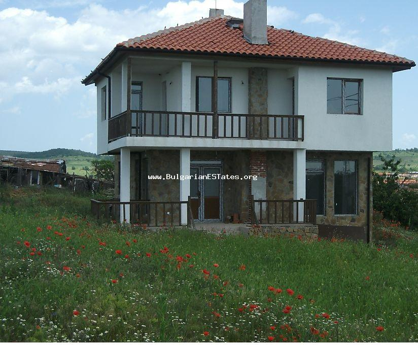 New charming detached two-storey house is for sale with a spectacular view of the Stara Planina Mountains in the village of Lyaskovo, just 20 minutes away from the regional centre of Bourgas and the sea.