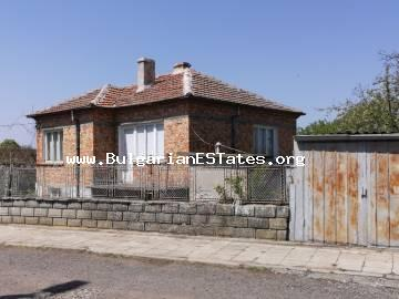 A large two-storey house is for sale in the center of the village of Bata, just 20 km from the sea.